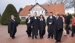 Pastorin Strelow, Pastor Grimmsmann, Pastor Schweitz, Pastorin Steinmeyer, Pastor Hoffmann, Pastorin Junglas